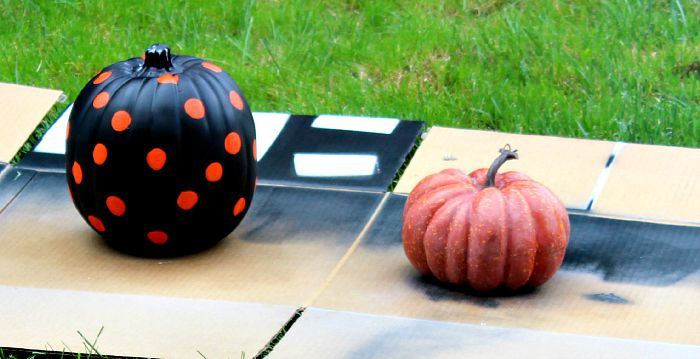 orange dots added to black pumpkin and light whitewash on orange to tone down the brightness