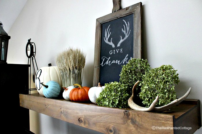 Autumn pumpkins and display on mantel