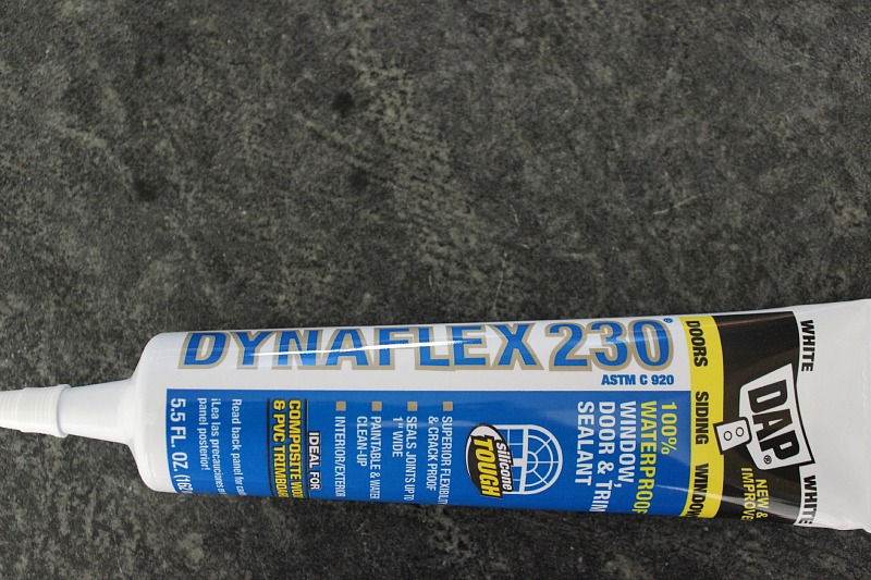We used Dap Dynaflex230 for caulking our board and batten.