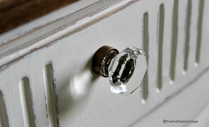 The top drawer knobs replaced with real glass knobs, matching the metal to the rest of the hardware