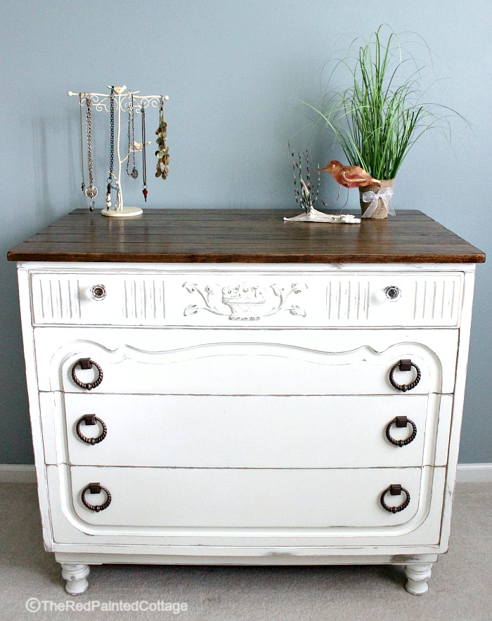 Legs, planked top, repainted and glass knobs for the top drawer transform this dresser into a gorgeous piece of furniture